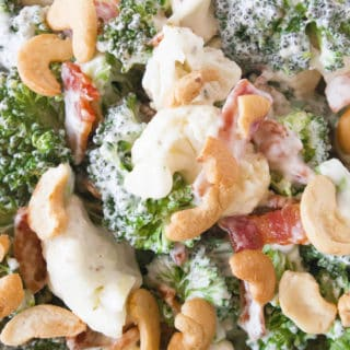 Broccoli Ranch Cashew Salad- a simple side salad that even broccoli haters love! Tossed with cauliflower, green onions, bacon and cashews! Yum!