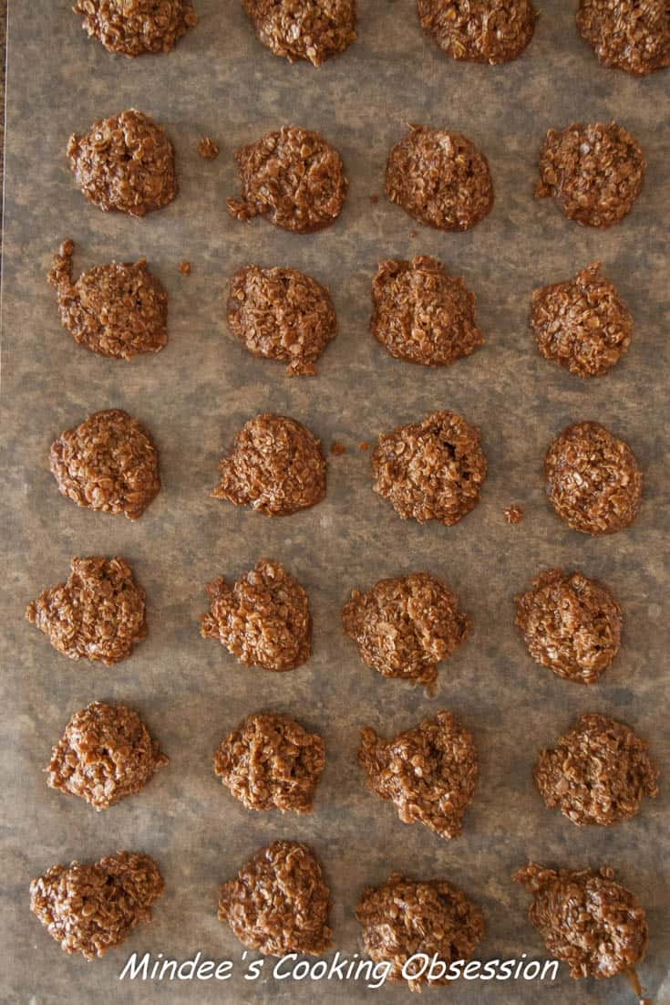 Chocolate No Bake Cookies scooped out onto wax paper to cool.