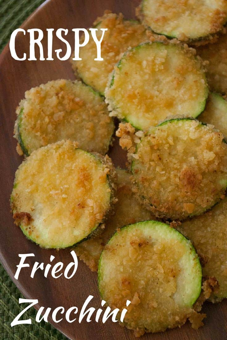Crispy Fried Zucchini- Do you have too much zucchini? Try some crispy fried zucchini! This addictive side dish is a great way to use up that over abundance of zucchini.