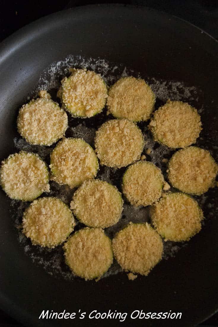 Zucchini frying in butter.