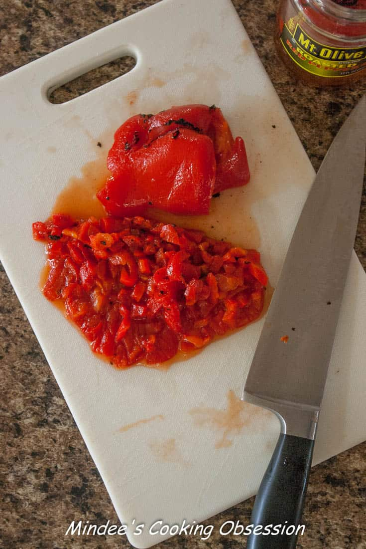 Roasted red peppers for Ham and Cheese Roll Ups chopped up.