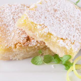 Lemon Bars on a dessert plate.