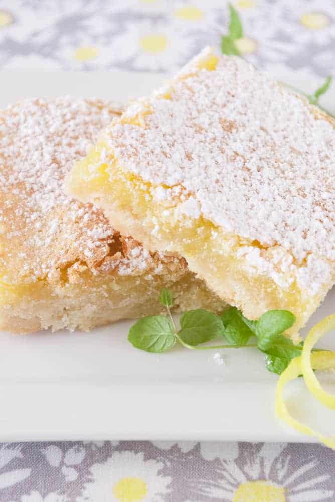 Lemon Bars on a dessert plate.