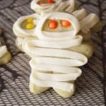 Easy Mummy Cookies Sugar cookies with M'n'M eyes and a frosting wrap make up these easy mummy cookies! Kids love the spooky fun and you'll love how simple they are!