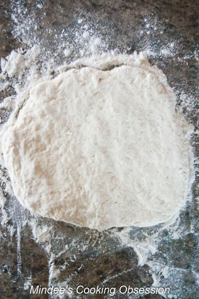 Scone dough patted out to between 1/4 to 1/2 inch thick.