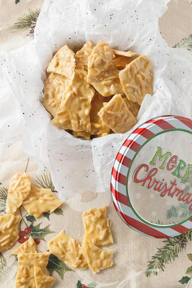 Almond brittle in a Christmas tin.