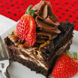 Cheesecake Swirled Chocolate Cake Cheesecake swirled chocolate cake is as easy as it is delicious. You'll love this dense, moist cake with swirls of cheesecake throughout!