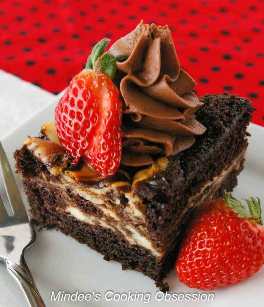 Cheesecake Swirled Chocolate Cake Cheesecake swirled chocolate cake is as easy as it is delicious. You'll love this dense, moist cake with swirls of cheesecake throughout!