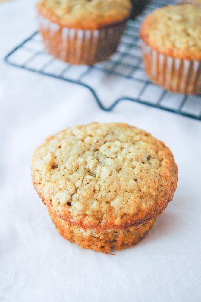 A banana oatmeal muffin ready to eat.