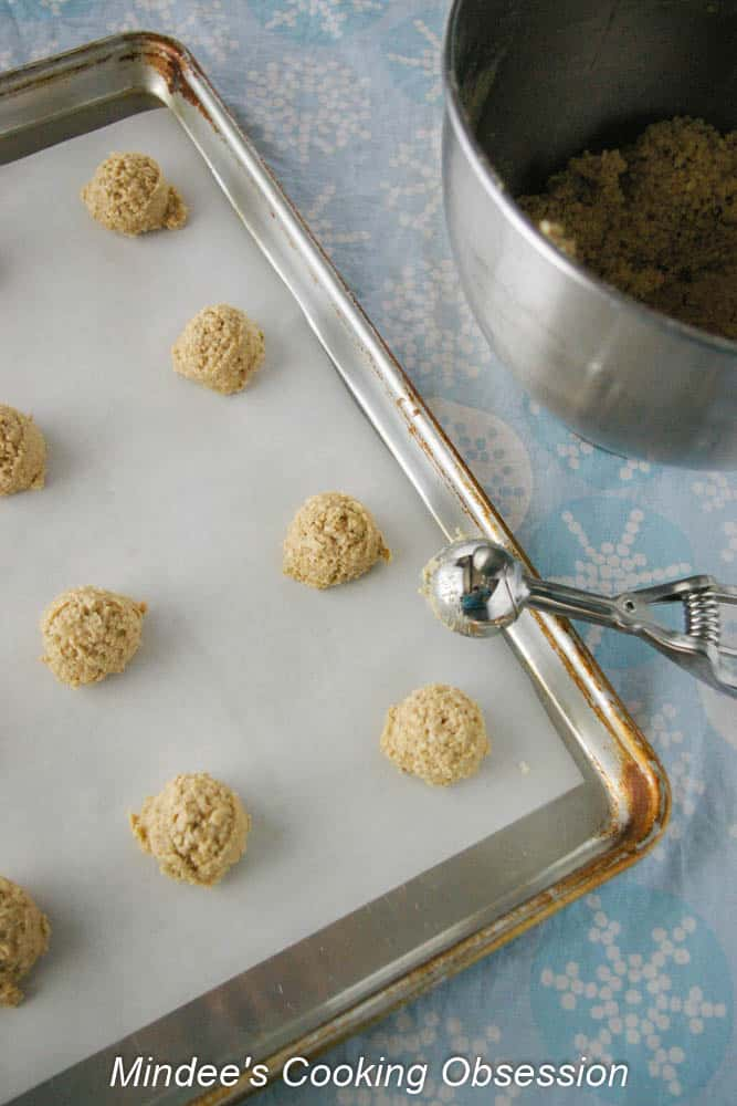 Soft Oatmeal Cookies scooped out onto a baking sheet.