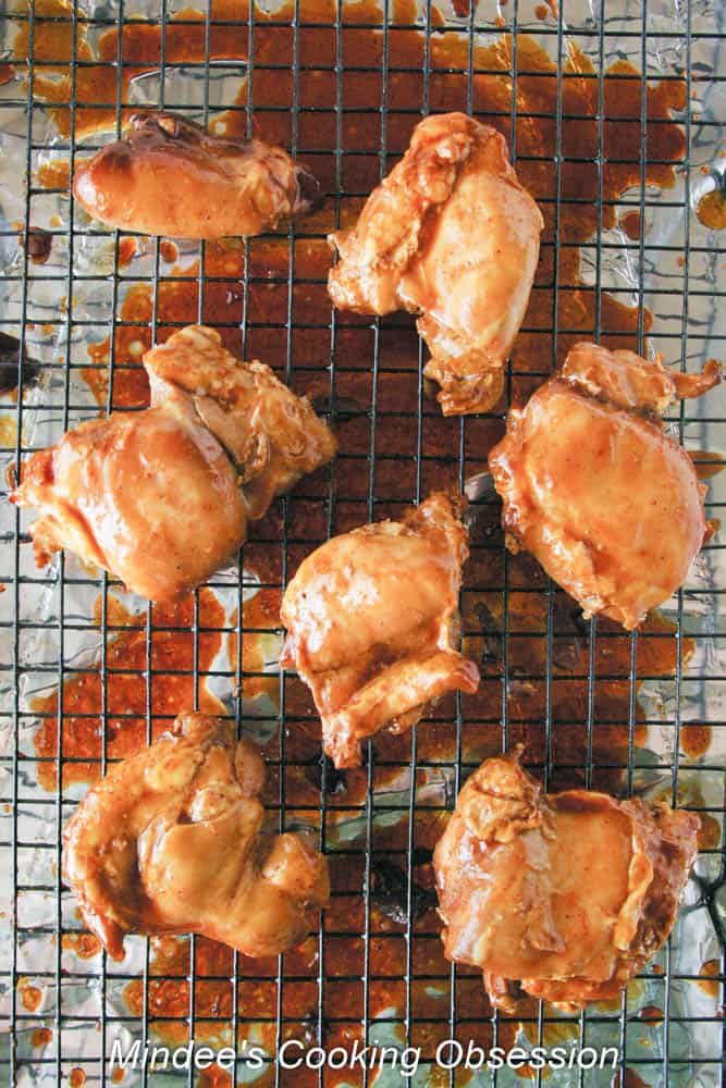 Honey Barbecue Glazed Chicken on a wire rack and brushed with remaining sauce.