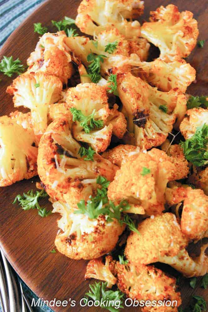 Smokey Parmesan Roasted Cauliflower Smokey parmesan roasted cauliflower is a flavorful side dish that will bring a little pop to any meal! Don't be surprised if you can't stop eating it!