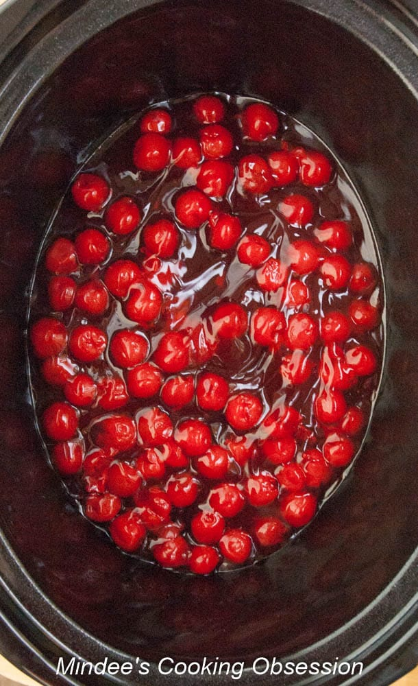 Cherry pie filling in the bottom of a crockpot.