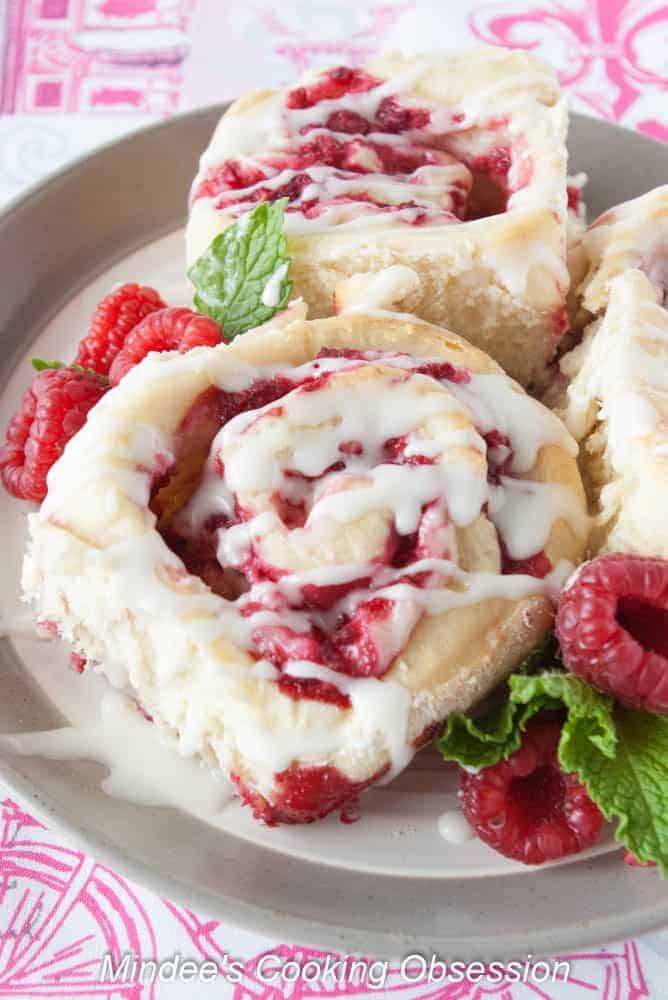 Raspberry Cheesecake Sweet Rolls-  try these delicious sweet rolls that are swirled with raspberries and a cream cheese filling!