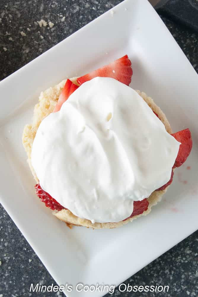 Strawberries topped with whipped cream.