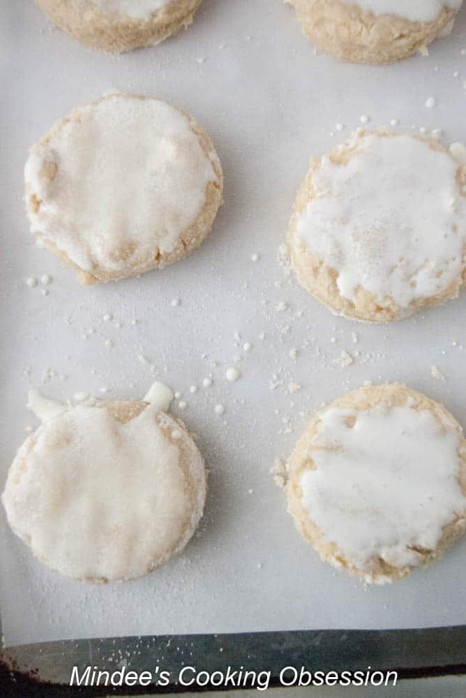 Sweet biscuits dough tops brushed with cream and sprinkled with sugar.