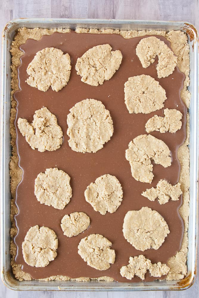 Remaining oatmeal dough dotted across the top of the fudge layer.