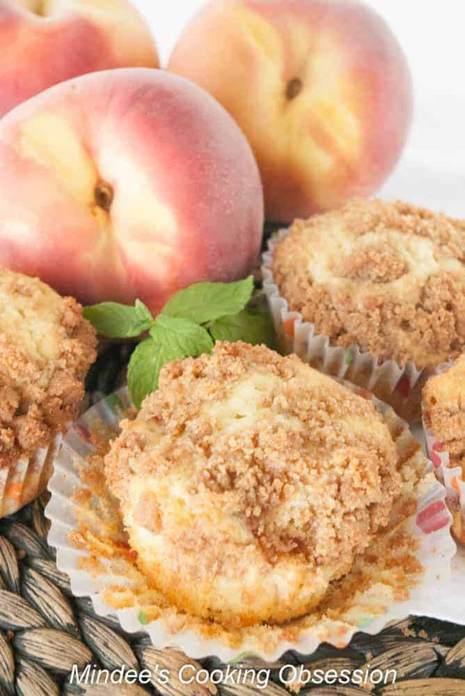 Fresh Peach Muffins-Start your day with these scrumptious fresh peach muffins. You'll love their tender peach filled insides and crumb topped outside! Truly irresistible!