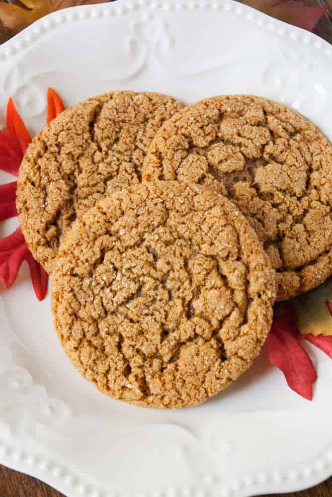 3 Molasses cookies on a plate.