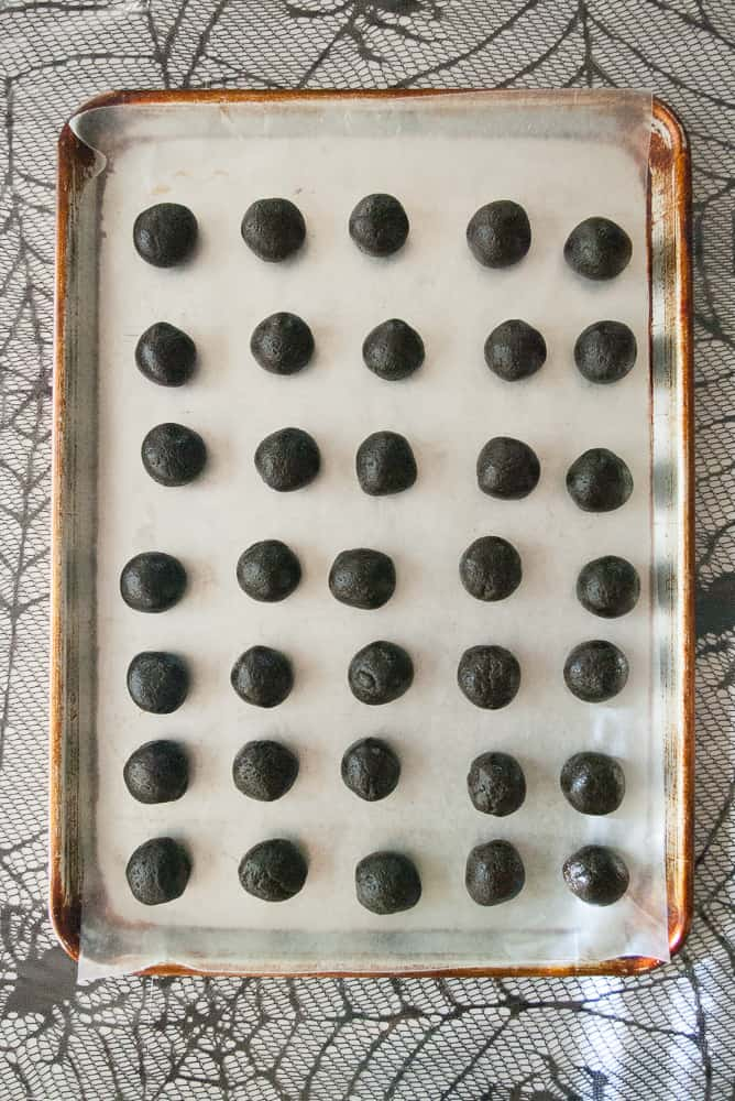 Oreo balls on a wax paper lined baking sheet.