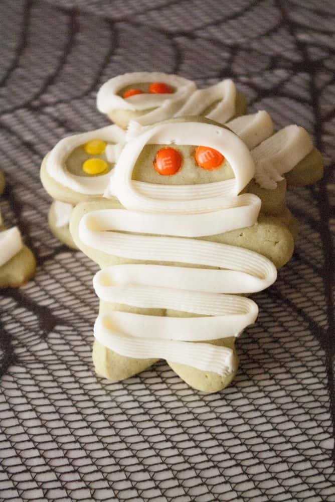 A little mummy cookie with orange eyes.