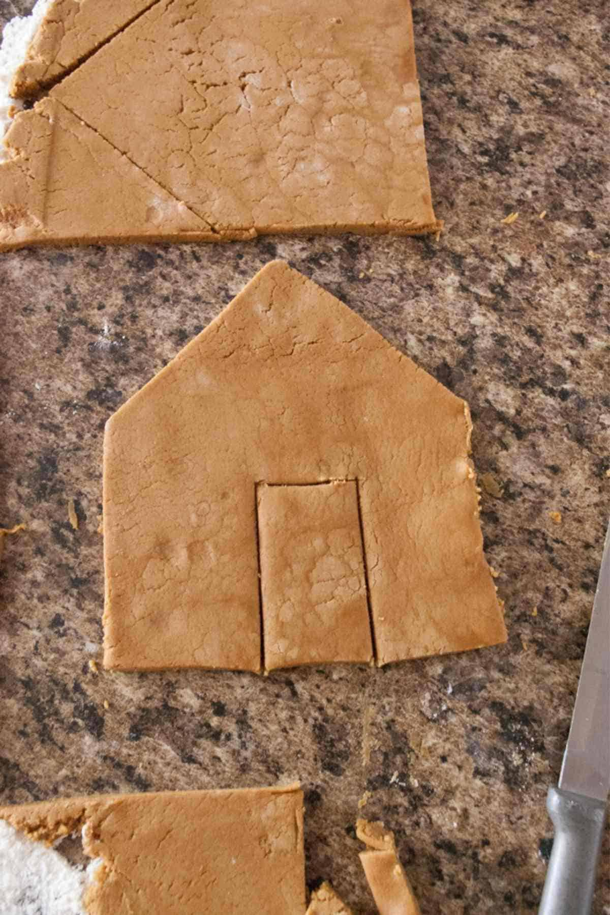 gingerbread house dough cut out from templates.