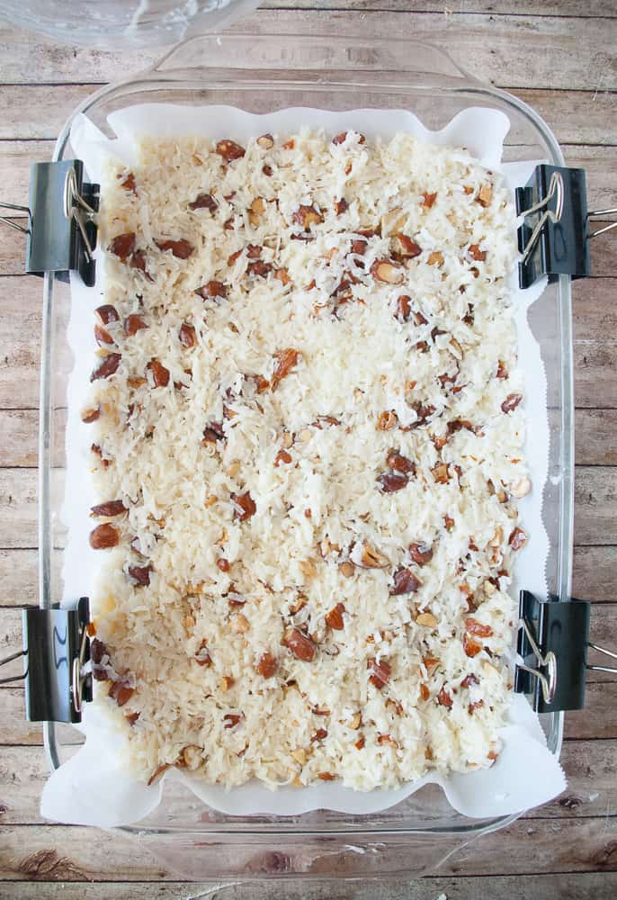 Almond Coconut Macaroon mixture pressed into a 9x13 baking dish.