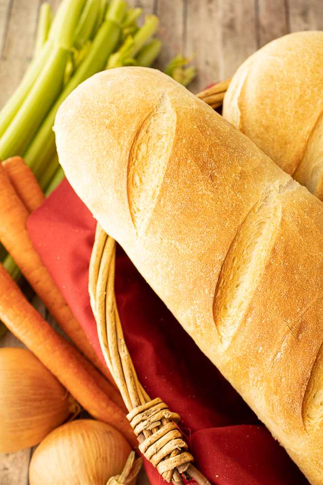 Loaves of french bread in a basket.
