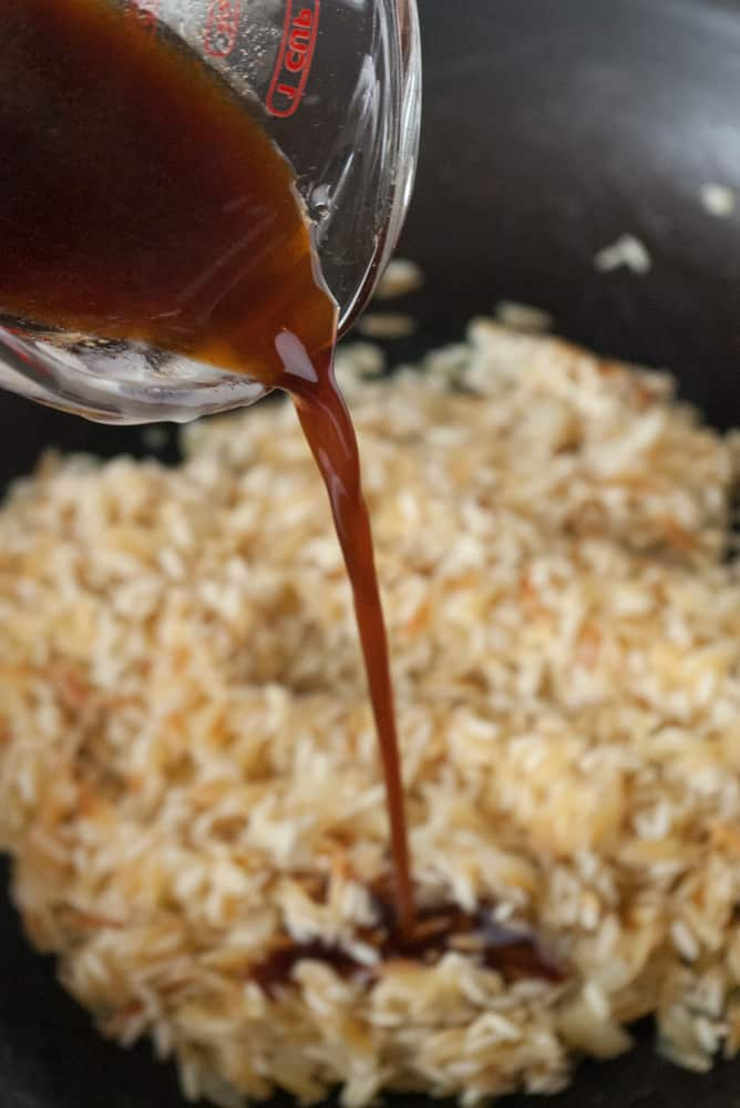 Honey Sriracha Sauce being added to the rice.