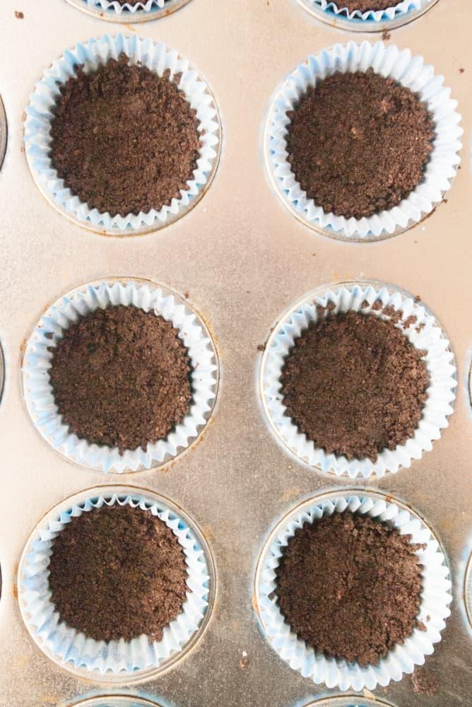 Oreo crust pressed into mini cupcake liners.