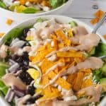 Southern BBQ Chicken Salad in a bowl and drizzled with bbq ranch dressing.