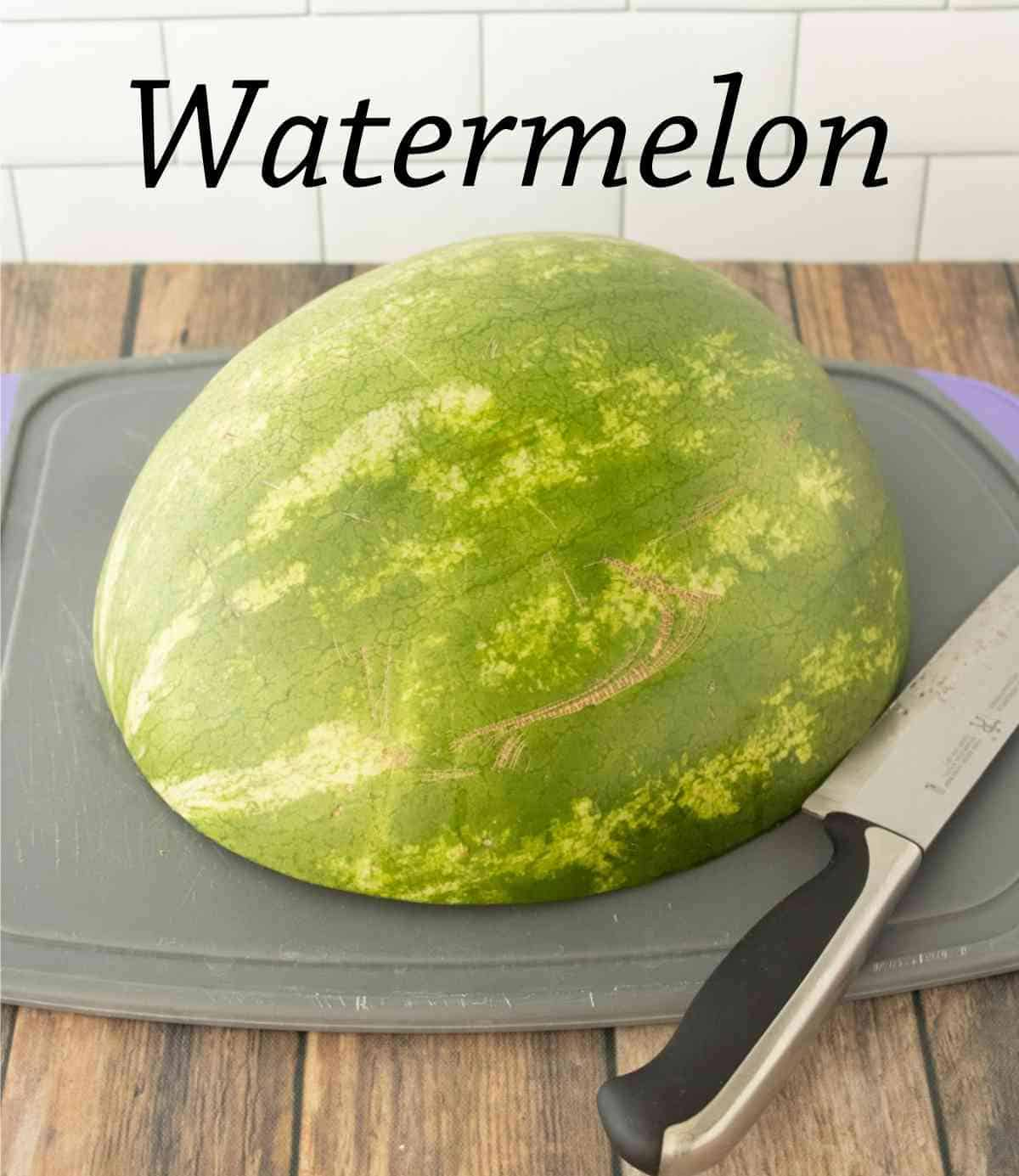 Melon cut side down on a cutting board.