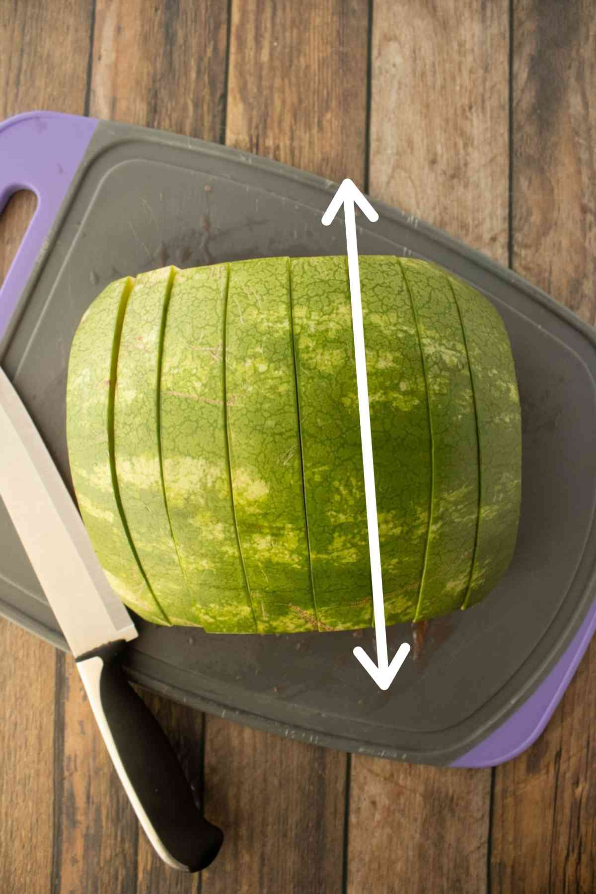 Cut the watermelon in vertical slices.