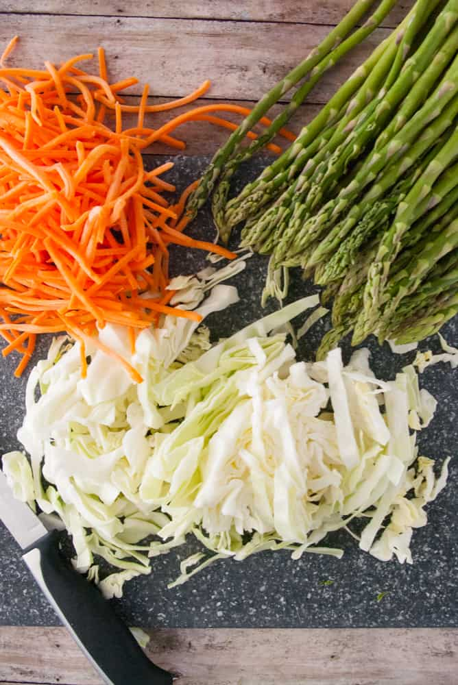 Asparagus, matchstick carrots and shredded cabbage.