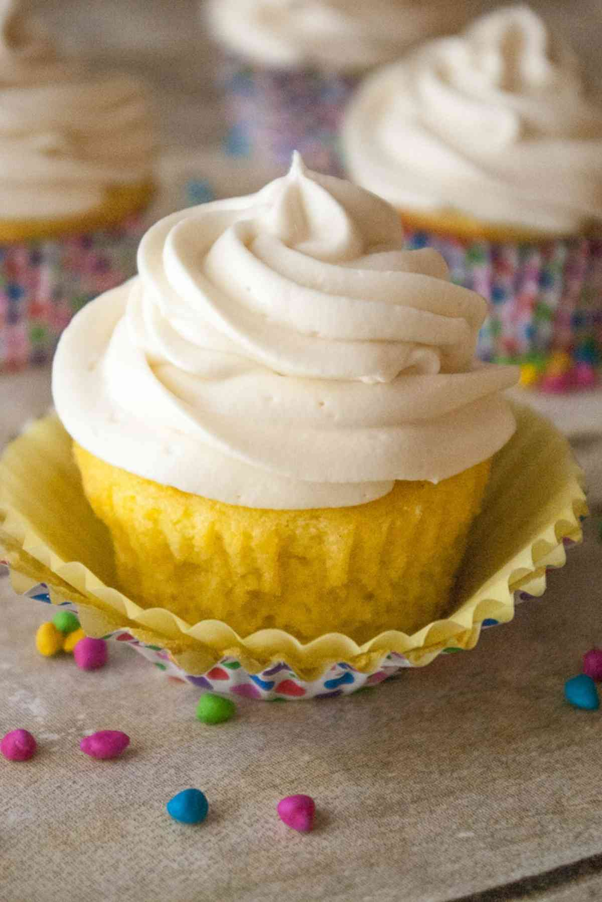 Whipped cream cheese frosting beautifully piped onto cupcakes.