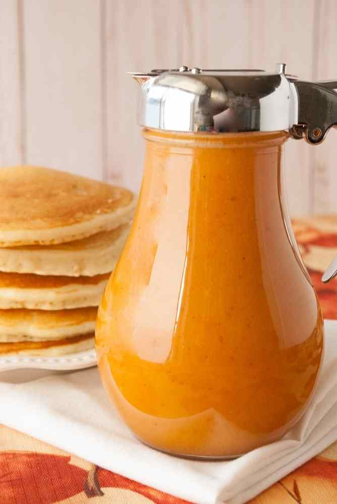 A syrup jar full of pumpkin pie syrup.