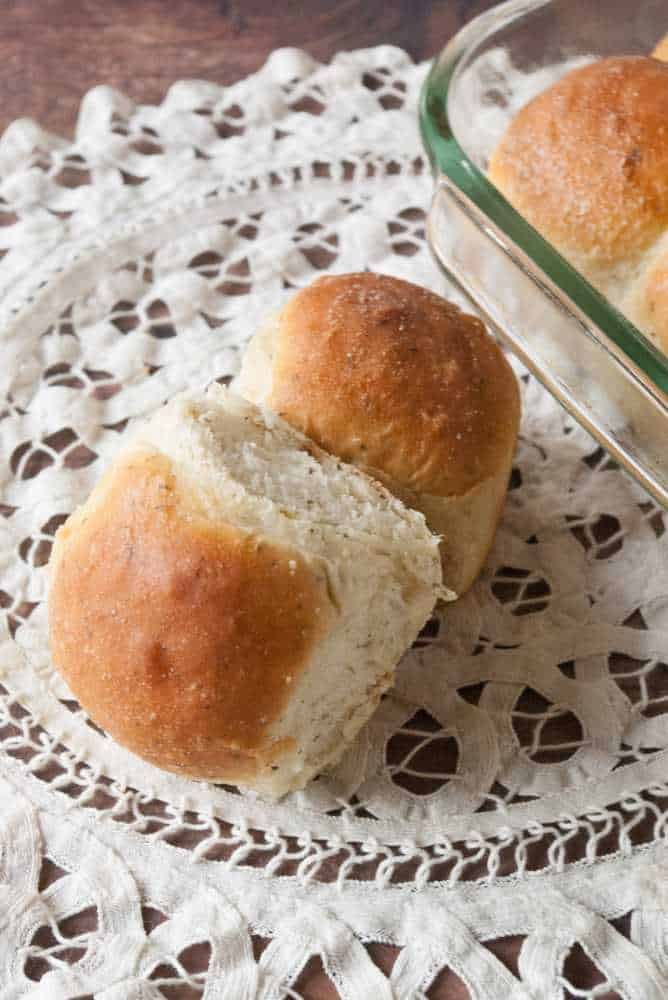 Garlic Butter Herb Rolls on a doily