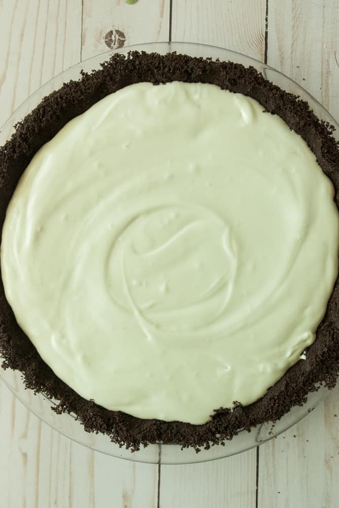 Grasshopper pie filling poured into the mint oreo crust.