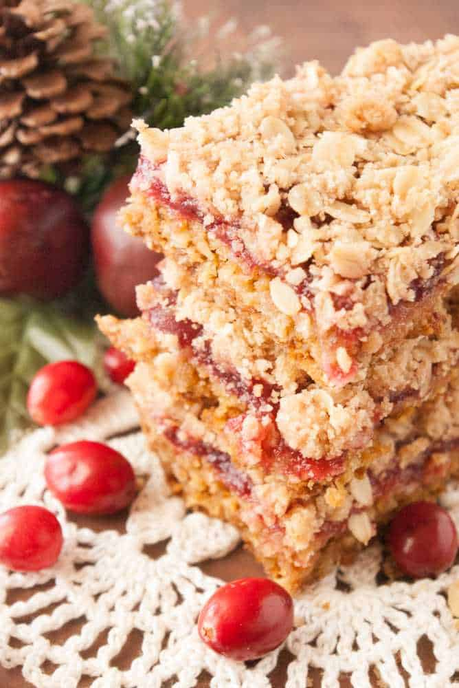A stack of cranberry crumble bars.