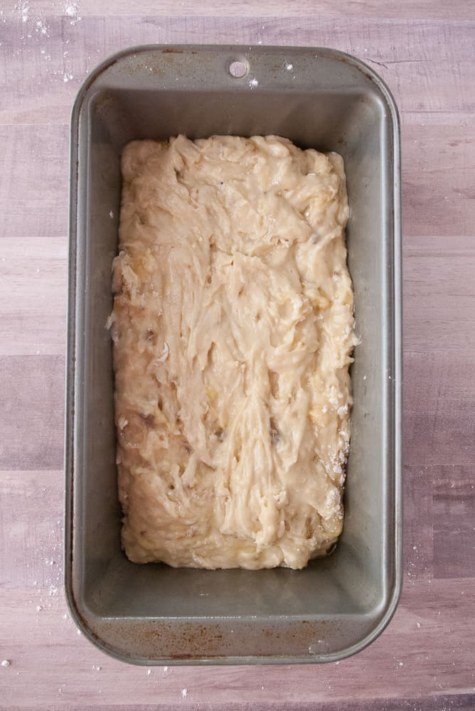 Banana bread batter in a loaf pan.