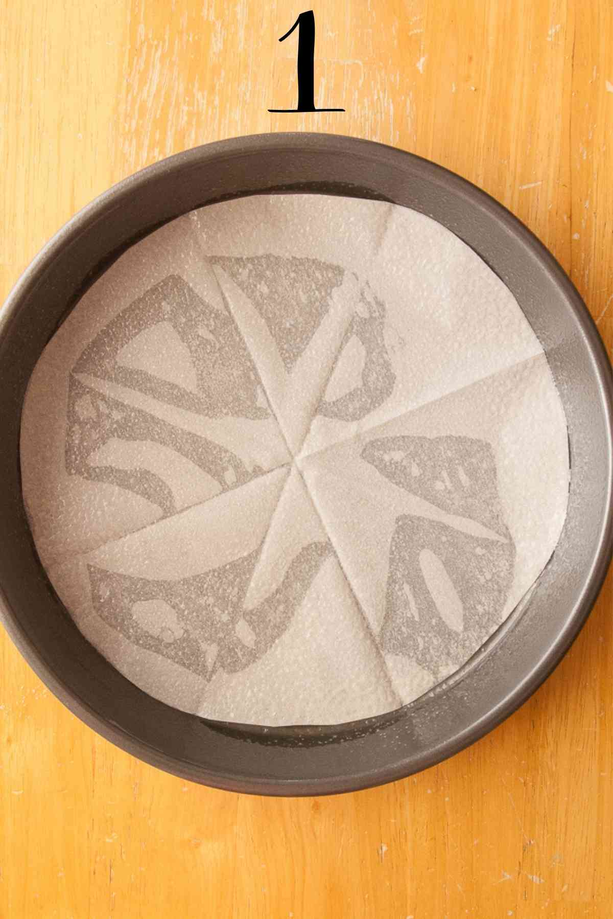 Preparation of the cake pan using a parchment paper circle.