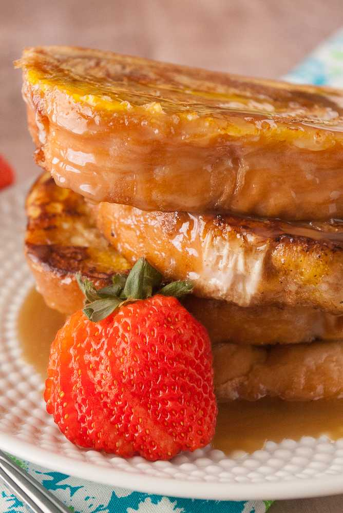 Stack of cinnamon swirl french toast drizzled with caramel syrup.