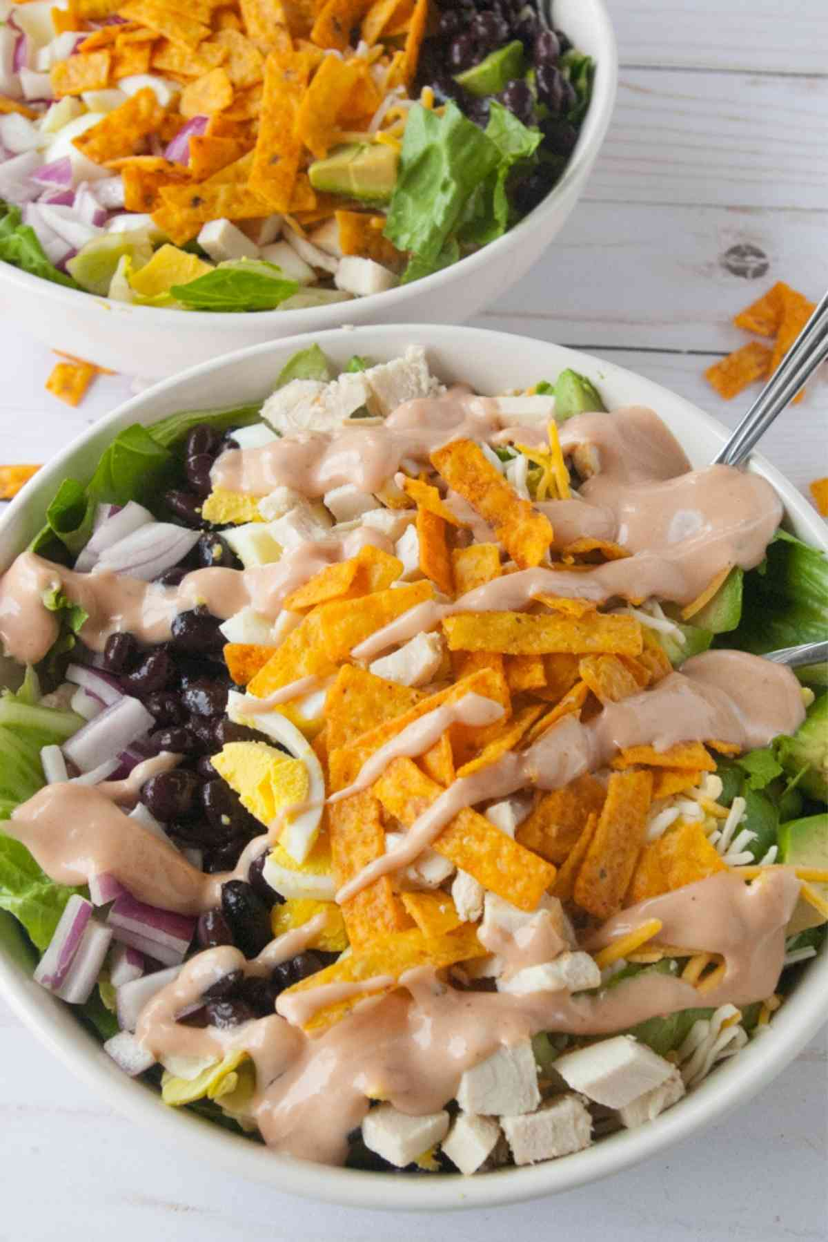Bowlful of lettuce topped with chicken, black beans, red onions, barbecue ranch dressing and more!