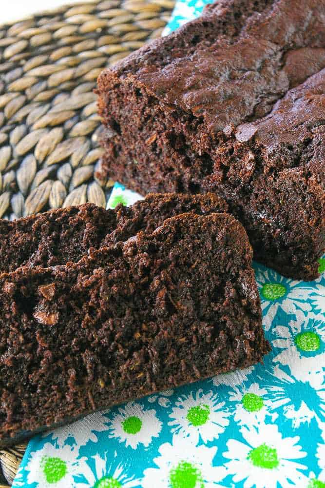 A loaf of chocolate zucchini bread sliced up.