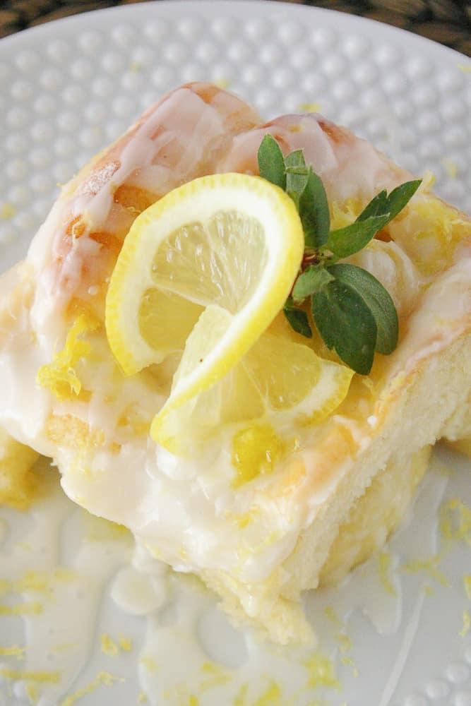 A lemon sweet roll on a plate.
