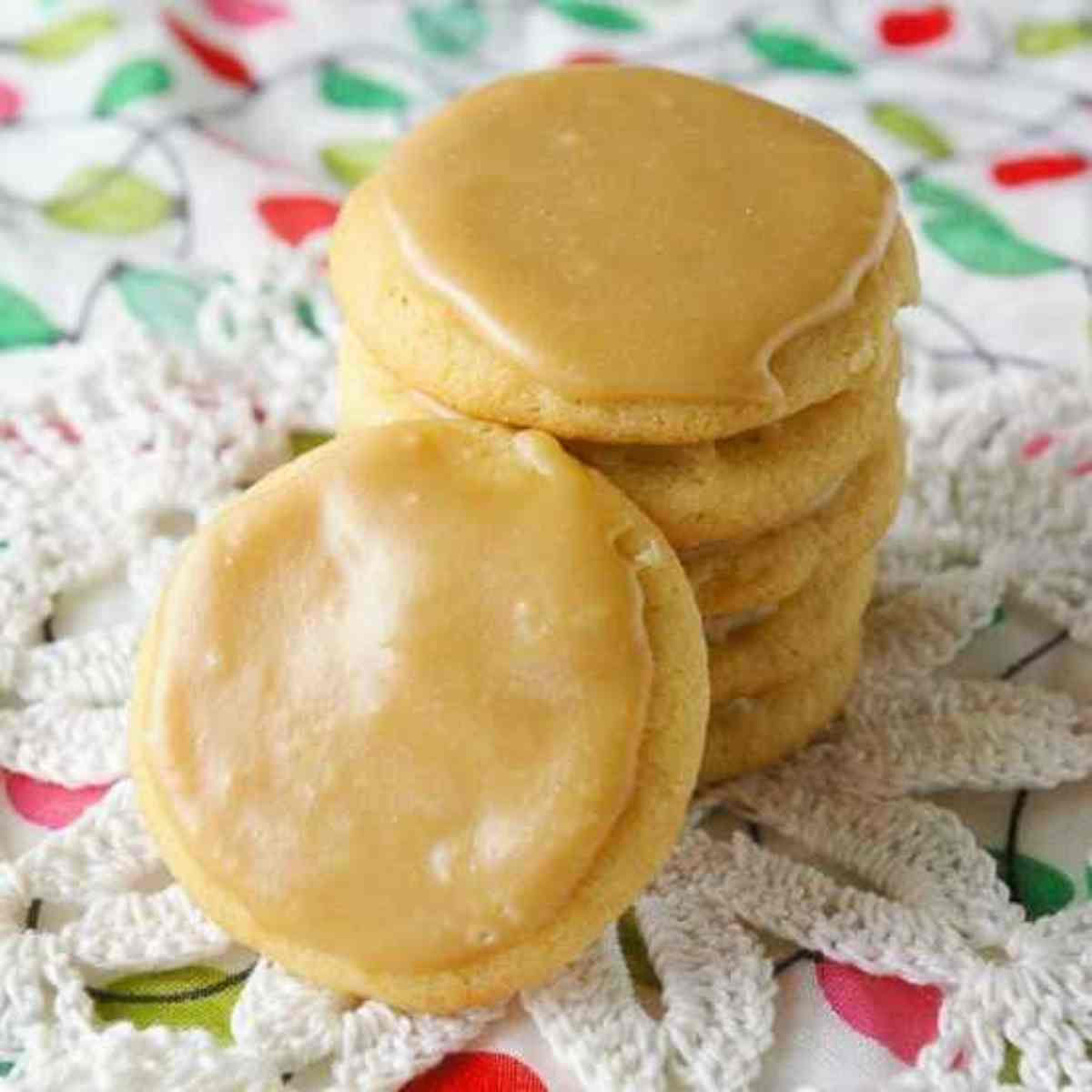 Stack of caramel butter cookies on Christmas fabric.