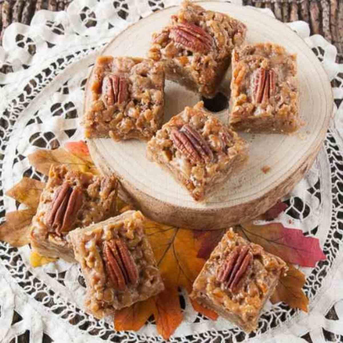 Pecan pie bars on a doily.