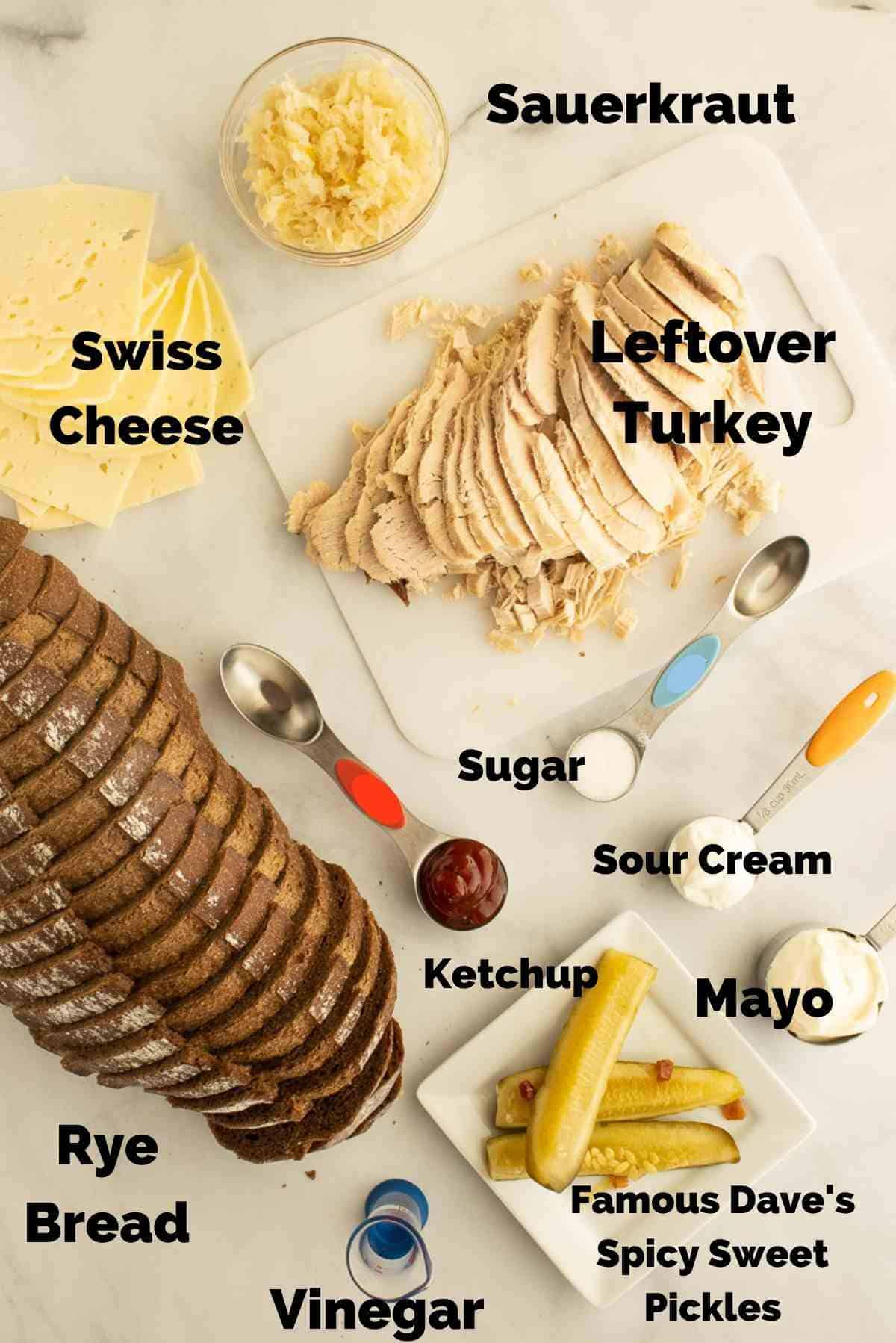 Ingredients needed to make turkey reubens and thousand island dressing.