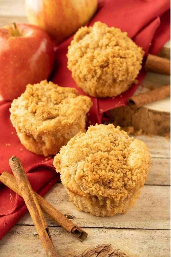 3 Apple Cinnamon Muffins on a towel.