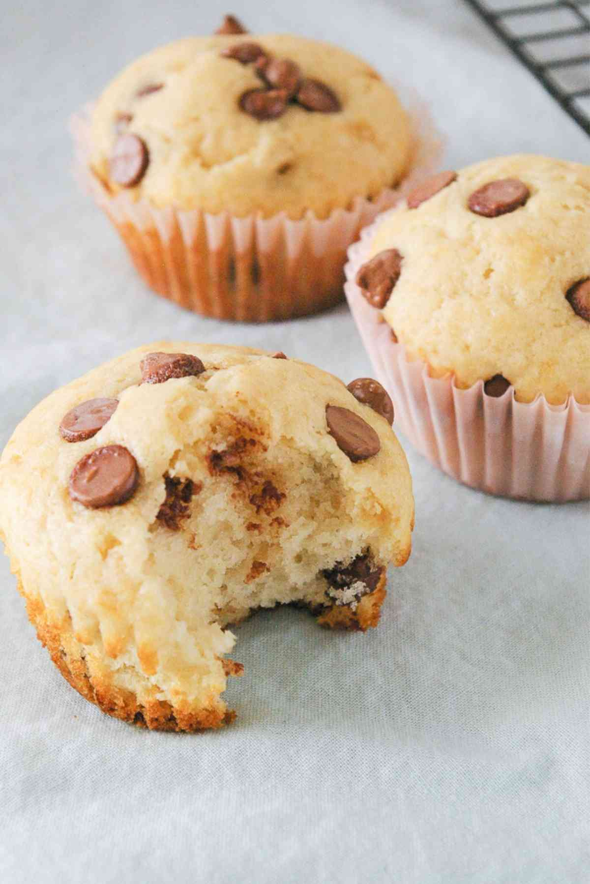 Chocolate chip muffin with a bite out of it.